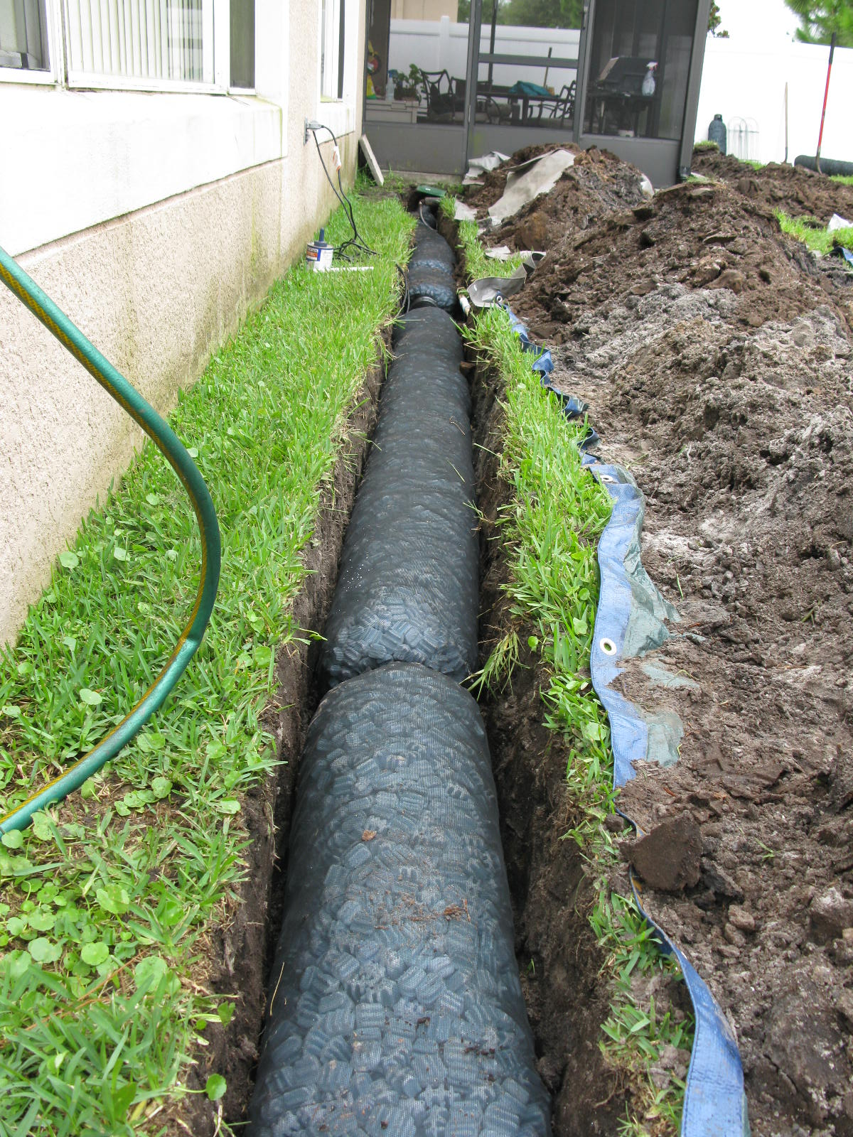 The nds ez drain pre constructed french drain installation for Outside drainage system